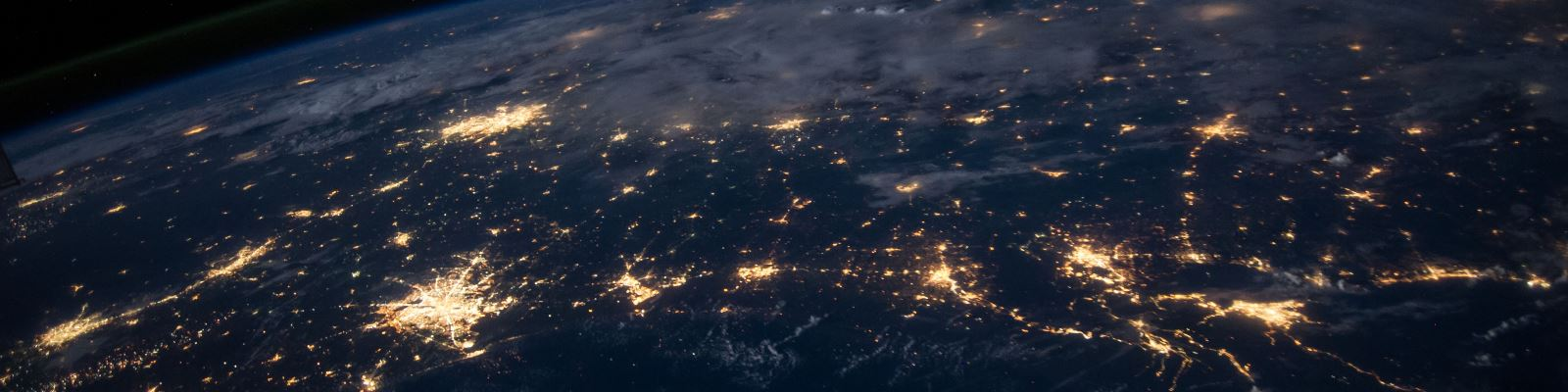the earth from space, showing lights from cities